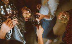women holding wine