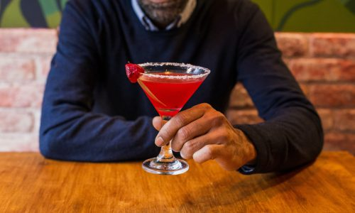 man holding cocktail