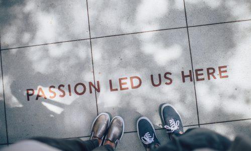 'passion led us here' on sidewalk
