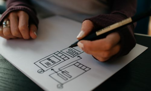 woman writing chart
