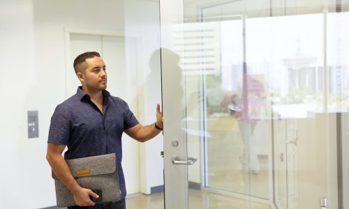 man at office door